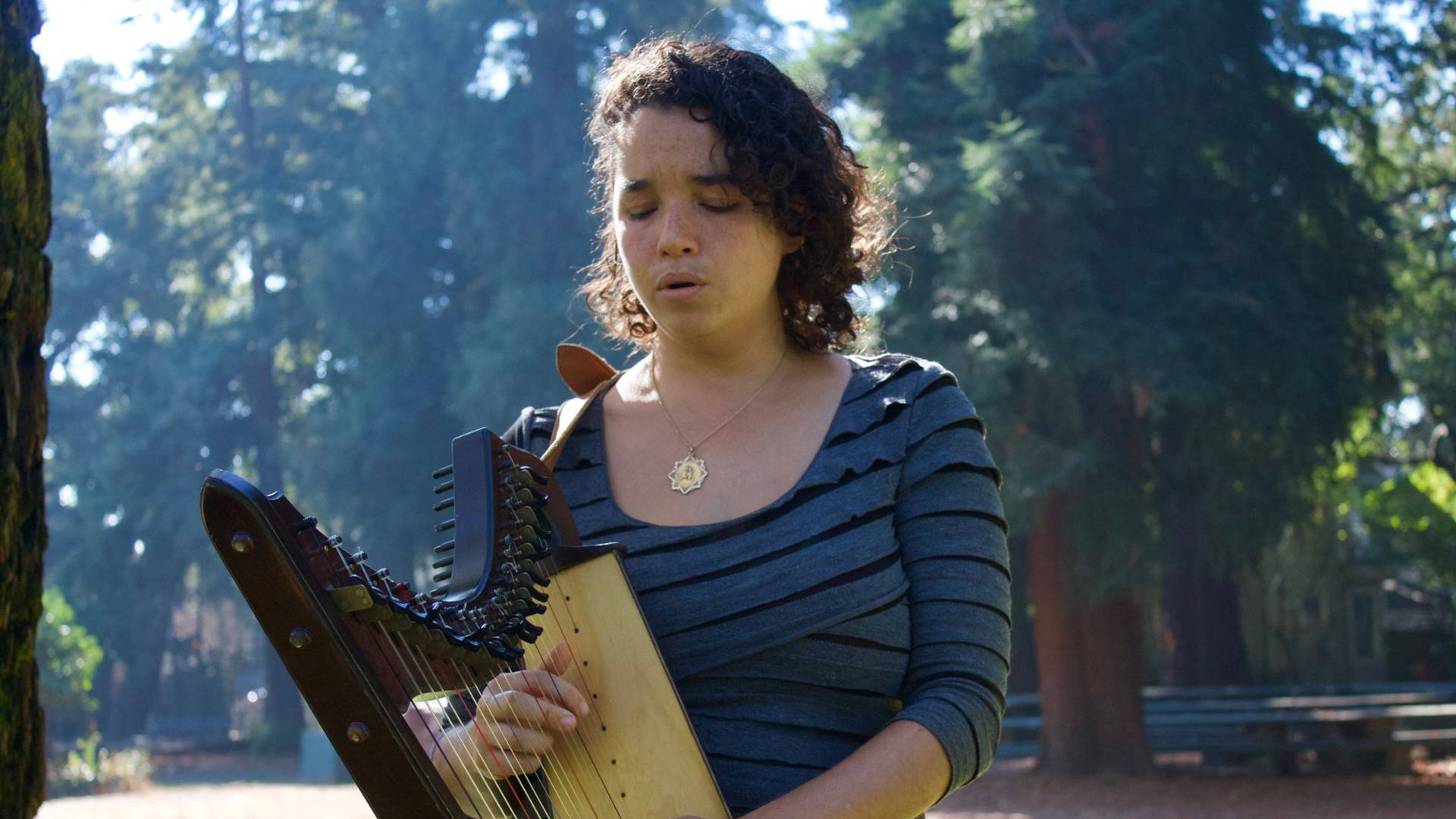 María José Montijo plays her harp at Dimond Park in Oakland. Audrey Garces