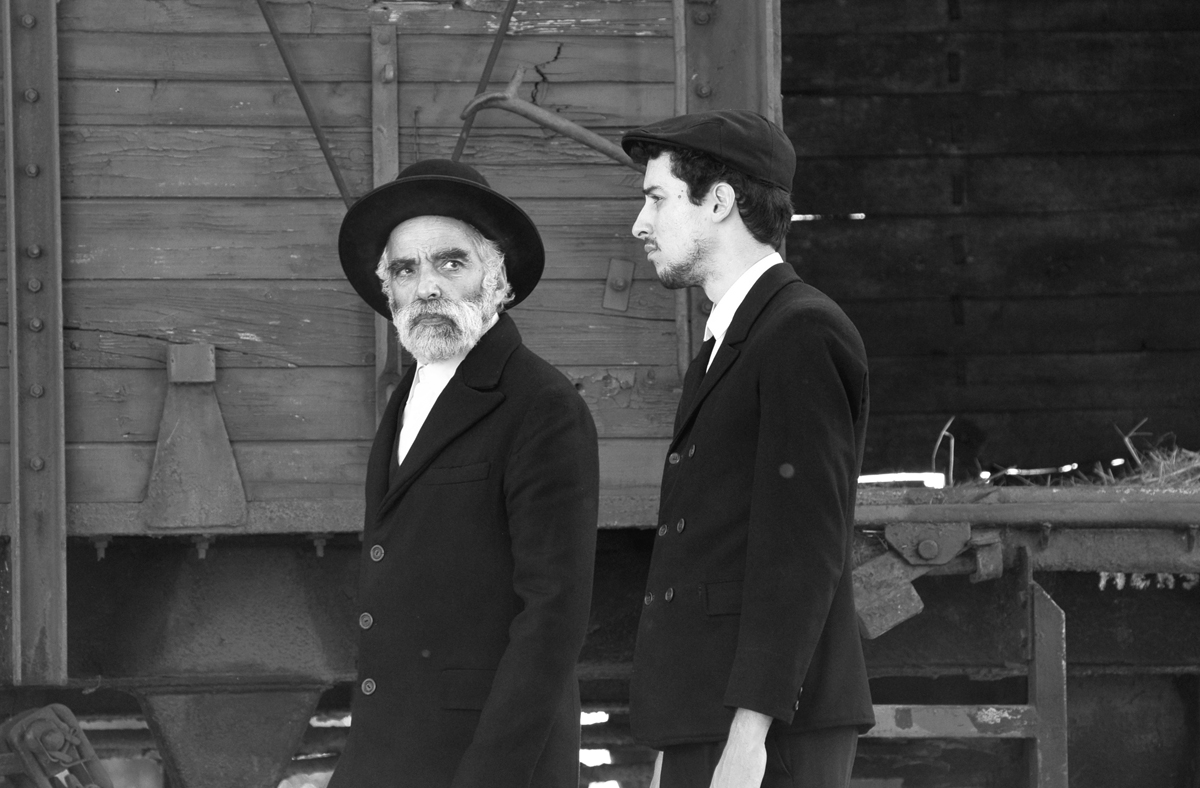 Hermann Sámuel (Iván Angelus) and his son (Marcell Nagy) arrive via train to a small village in Hungary full of secrets in '1945.'