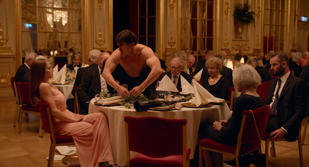 A disrupted dinner scene from 'The Square.'
