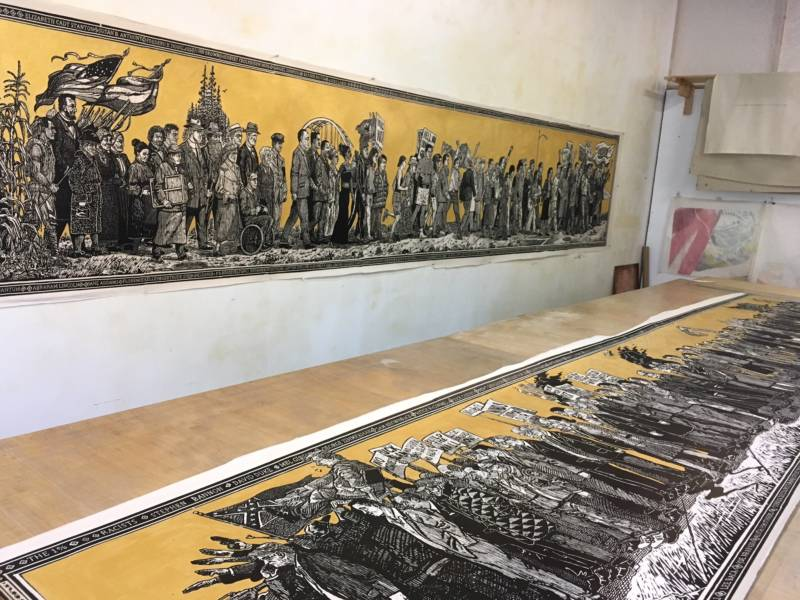 """A studio image of Sandow Birk and Elyse Pignolets """"American Procession"""" at Mullowney Printing in San Francisco"""