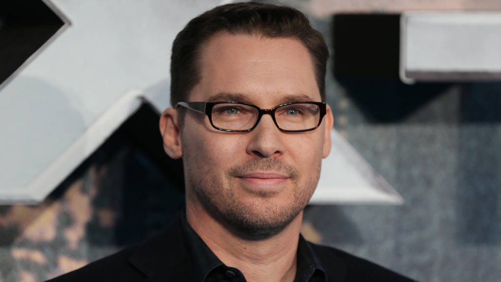 Bryan Singer poses on arrival for the premiere of X-Men Apocalypse in central London on May 9, 2016.
