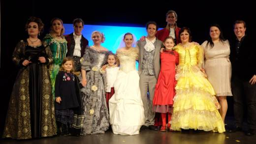 Cinderella composer Alma Deutscher (in orange) and her sister Helen with the cast of 'Cinderella' after the Vienna premiere.