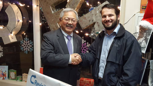 Mayor Ed Lee poses with Stevens Books owner Joseph Volansky while visiting an art installation at the bookstore on Dec. 8, three days before he died.