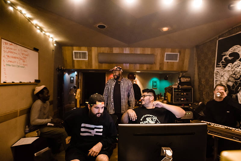 Text Me Records engineer Jorge Hernandez (center) in a session with artists Channel Tres and 1-O.A.K. at New Monkey Studios in Van Nuys.