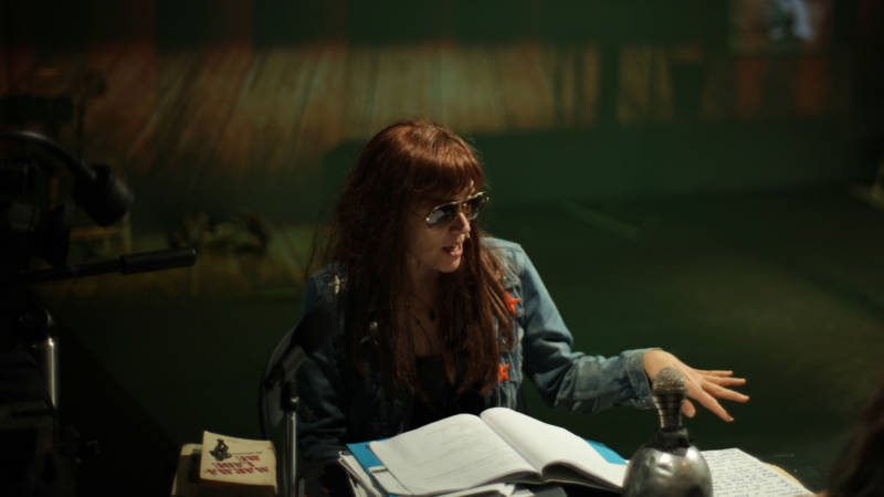 Jill Johnston (Kate Valk) surveys her desk for clues to a wild evening in 'Town Hall Affair' by the Wooster Group.