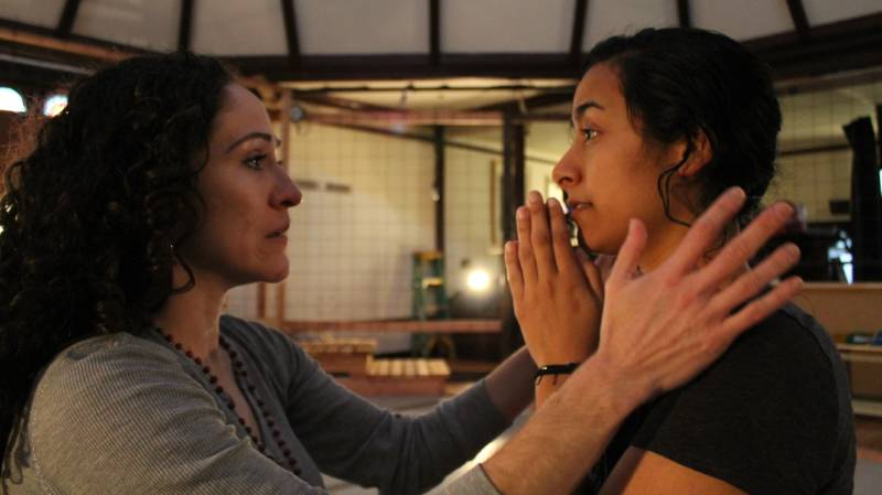 (L to R) Juana (Sarita Ocón) confronts the angelic Carmen (Carla Gallardo) in the Ubuntu Theater Project's production of 'To the Bone' by Lisa Ramirez.