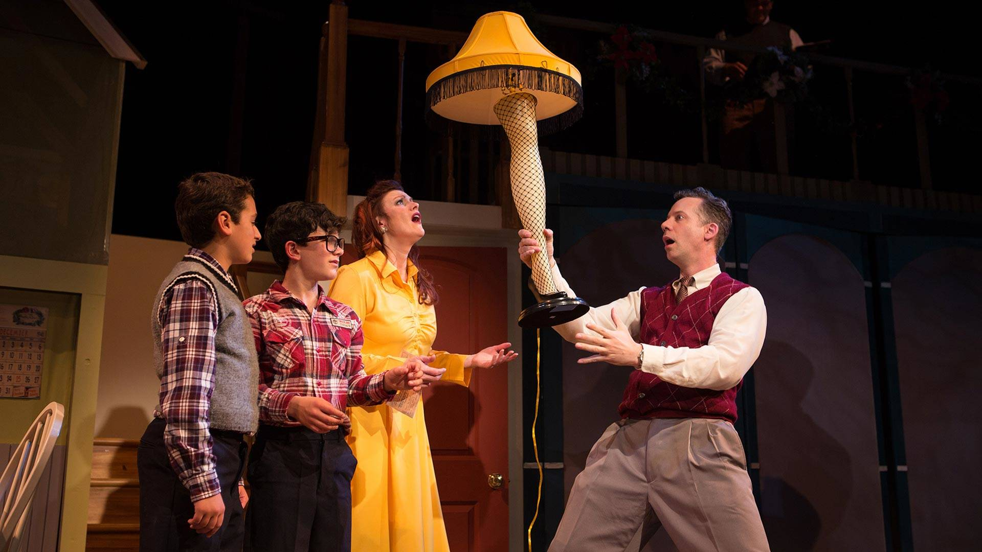 The Old Man (Ryan Drummond, right) unveils his major award as Randy (Jake Miller), Ralphie (Jonah Broscow), and Mother (Abby Haug) express their puzzlement in 'A Christmas Story: The Musical' at SF Playhouse.