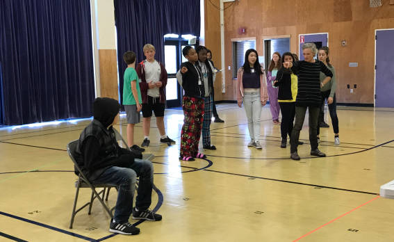 Director Erin Neff works with 8th graders from Rooftop Alternative School on a scene from the new opera 'Harriet's Spirit'