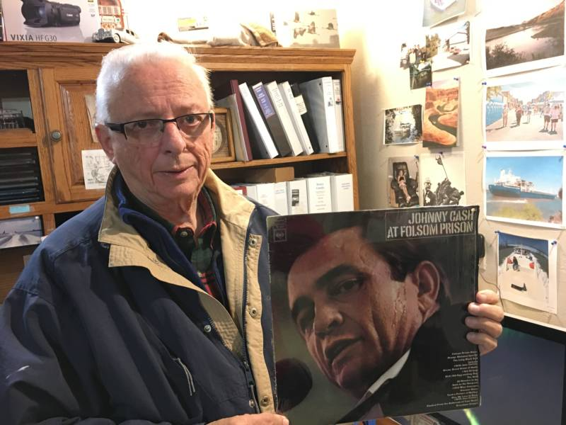 Gene Beley, formerly a reporter with the Ventura Star Free Press, poses with his copy of Cash's seminal 1968 album. Beley traveled alongside Cash for the gig and recorded the rehearsal the night before and the concert.