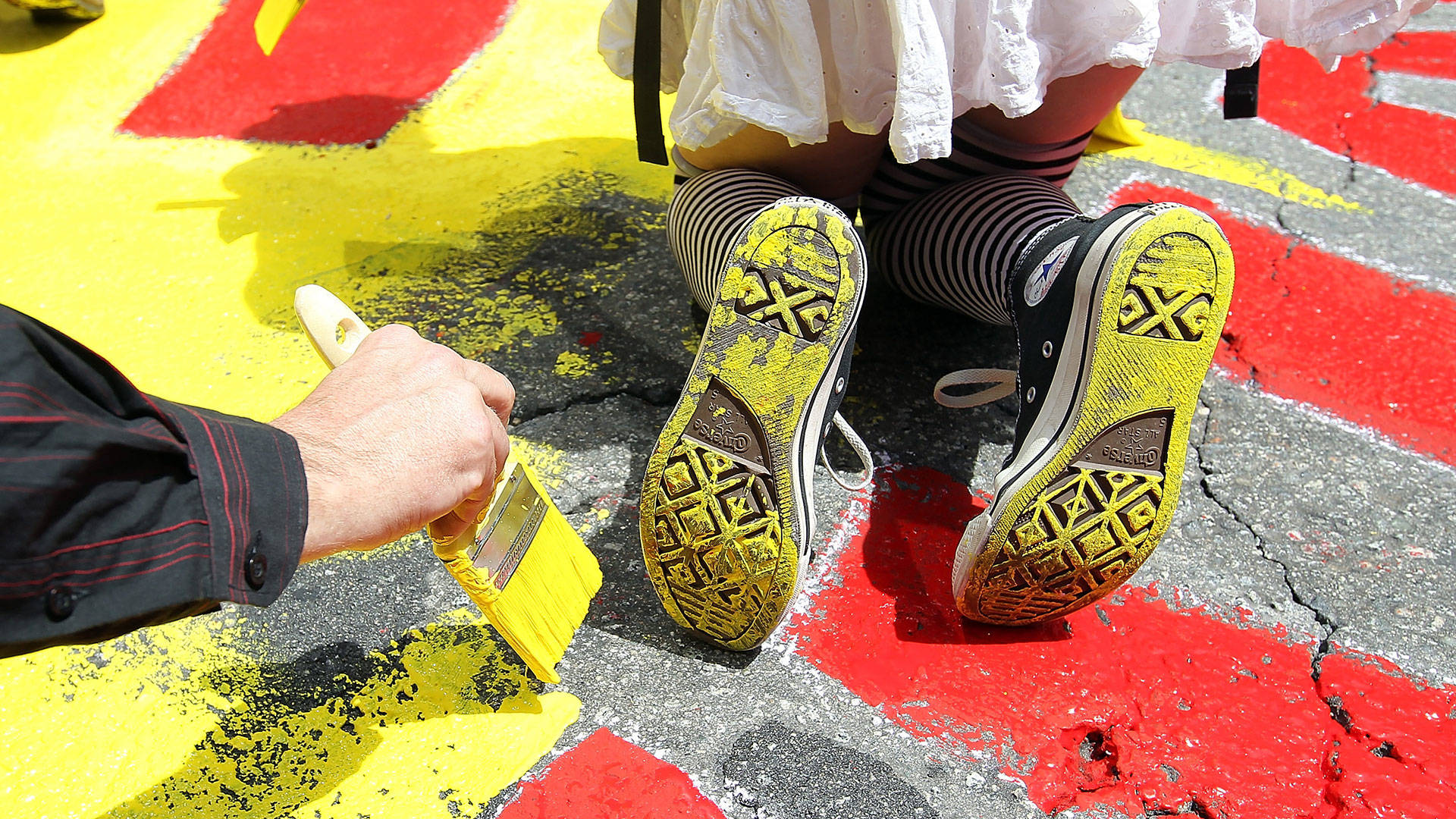 Demonstrators paint a mural on the street at the intersection of Market and Montgomery Streets in San Francisco in 2012. Justin Sullivan/Getty Images
