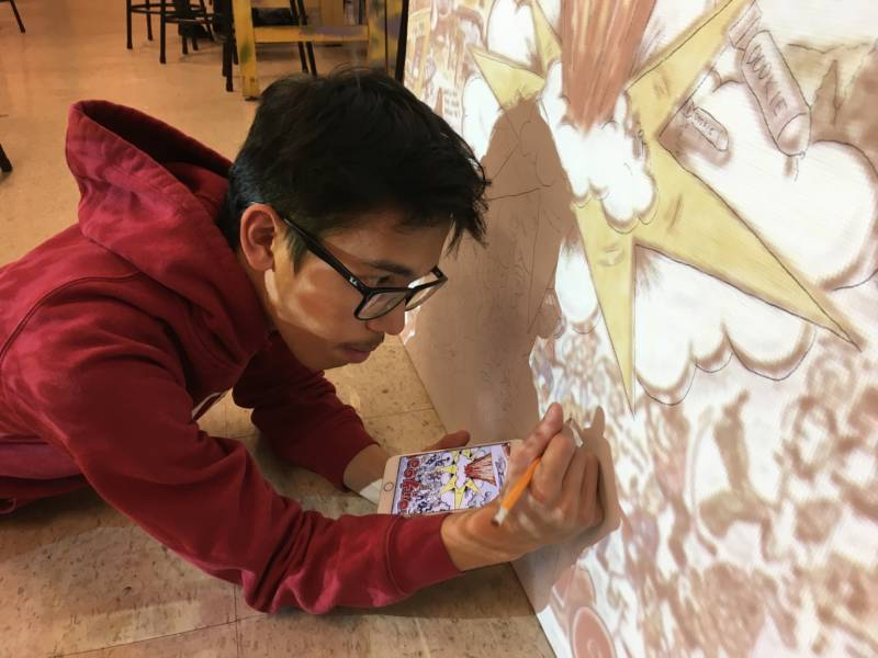 Student Jason Capuyan works on his mural -- the cover art for Green Days 1994 album 'Dookie'.