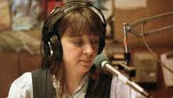 One of KPFA's longtime hosts, Mary Tilson, at the mic.