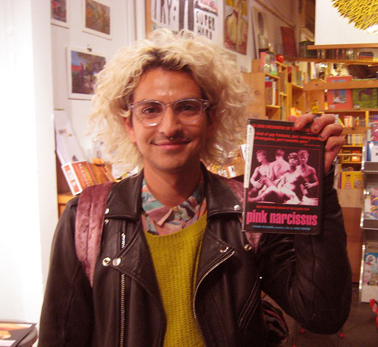 Film selector Jai Carillo holding his choice, James Bidgood's 1971 'Pink Narcissus.'