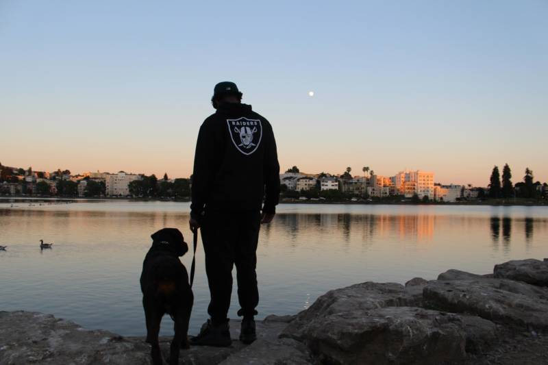 Rocky takes his human, Keith Gregory, on an evening walk around Lake Merritt.