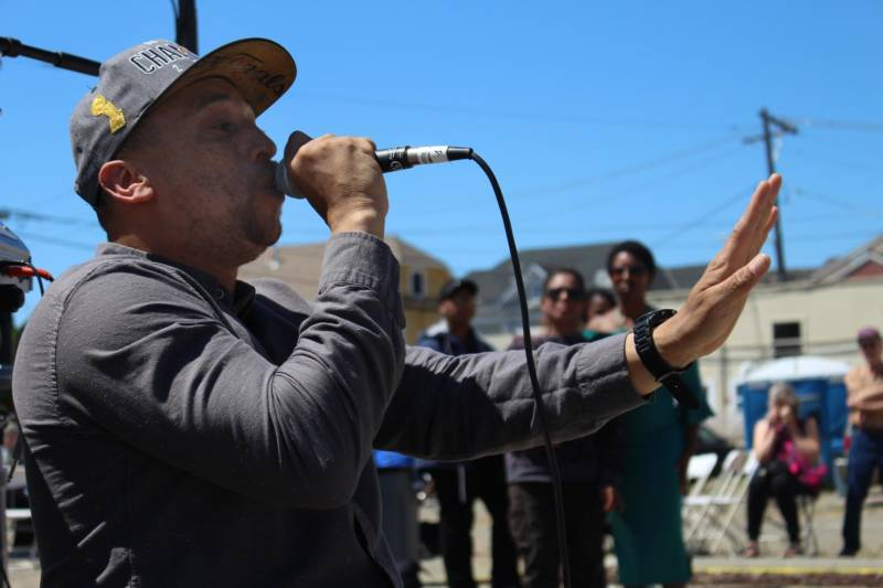 Kev Choice, ever animated, performs at an event in West Oakland.