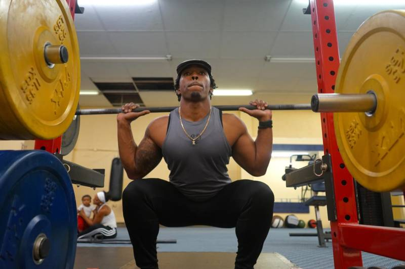 Ant Petty getting active on the weights as his family watches in the background.