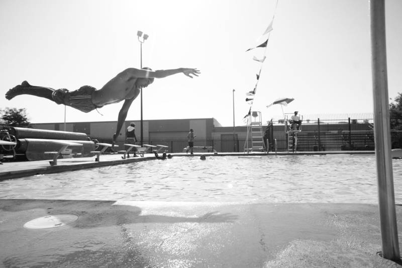 West Oakland's own Beejus takes a dive in the DeFremery (Lil' Bobby Hutton) Park pool.