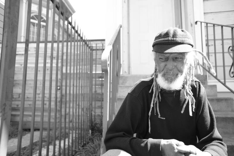 The late Elder Freeman, former Black Panther party member, sitting on his porch in West Oakland.