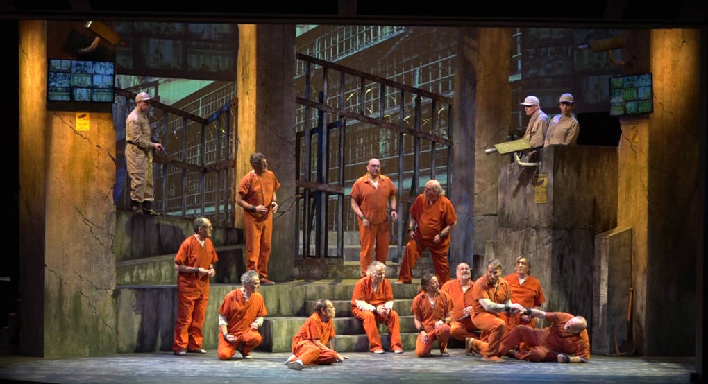 """The chorus for West Coast Opera's production of Fidelio """"bask in the sunshine"""" on stage in Palo Alto."""