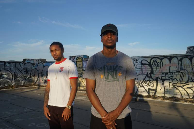 The Afro-Panamanian rap duo Los Rakas on top of the old train station in West Oakland.