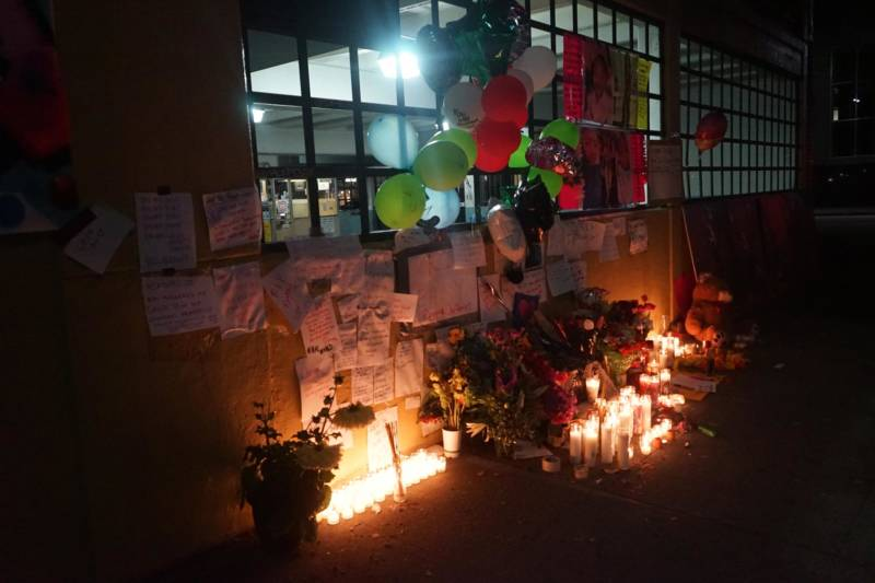 A streetside memorial for 16 year-old Reggina Jefferies in downtown Oakland.