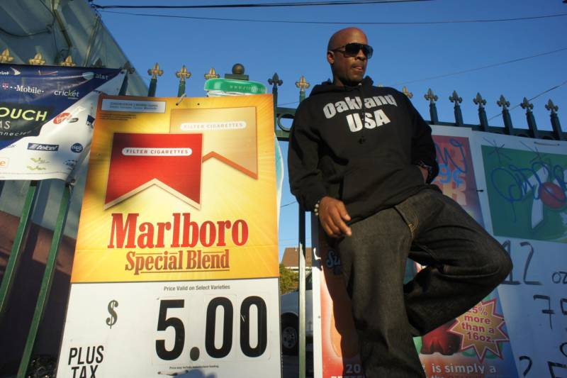 East Oakland native, rapper Richie Rich, poses for a photo outside of a store in North Oakland.
