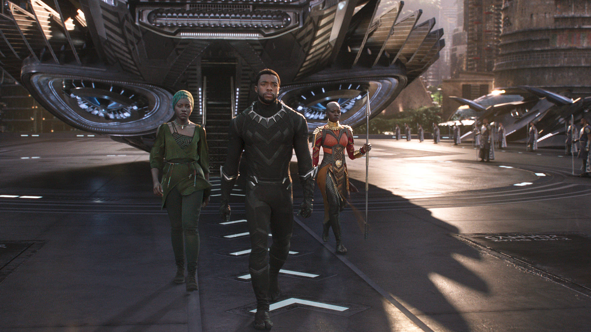 Nakia (Lupita Nyong'o), T'Challa/Black Panther (Chadwick Boseman) and Okoye (Danai Gurira), left to right, in Marvel's 'Black Panther.' Film Frame © Marvel Studios 2018
