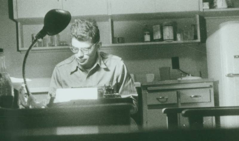Allen Ginsberg at his typewriter, date unknown.
