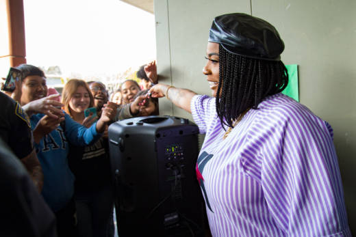 Oakland rapper Kamaiyah gives students at Hayward High School tickets to meet her for a screening of 'Black Panther.'