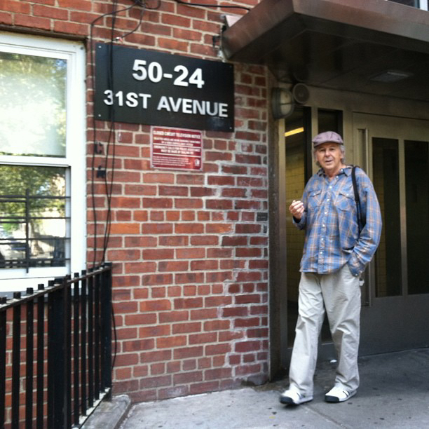 Ted Pushinsky in 2014, in front of his childhood apartment building in Woodside, Queens, NY where he lived until he was about 9 or 10 years old.