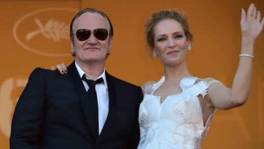Director Quentin Tarantino and actress Uma Thurman pose at the Cannes Film Festival in 2014. He acknowledges convincing her to do a dangerous driving scene which ended in a crash.