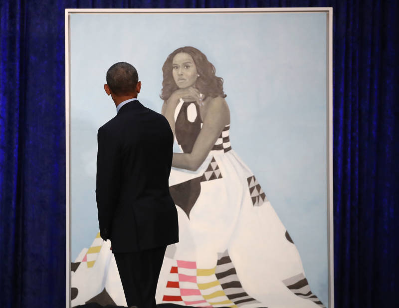 Former U.S. President Barack Obama looks at former first lady Michelle Obama's newly unveiled portrait during a ceremony at the Smithsonian's National Portrait Gallery.