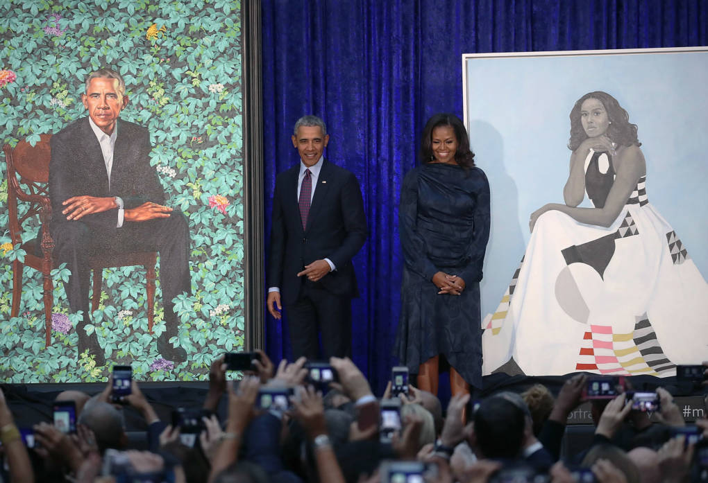 Former U.S. President Barack Obama and former first lady Michelle Obama stand next to their newly unveiled portraits during a ceremony at the Smithsonian's National Portrait Gallery.