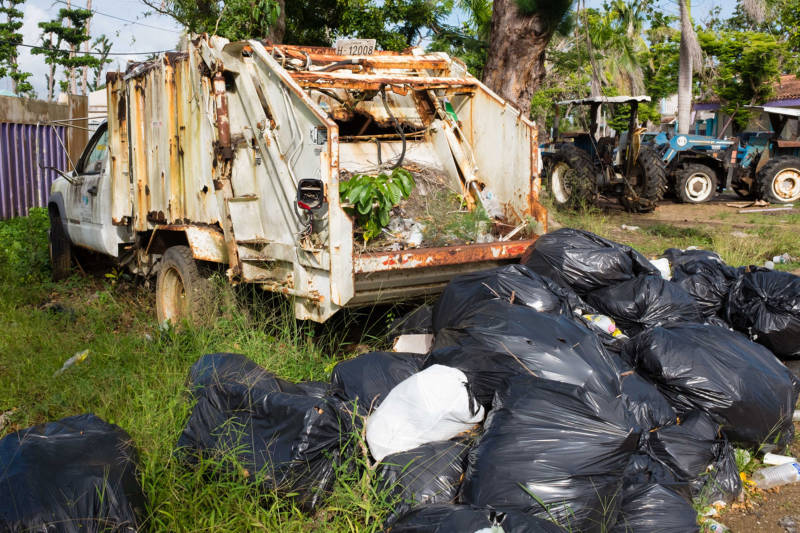 An immobilized garbage truck at a beachside resort in Punta Santiago, Puerto Rico. Tourism, an important sector in the Puerto Rican economy, has been slow to recover in the wake of Hurricane María.