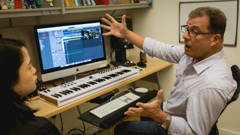 SFCM professor Clint Bajakian, a veteran composer who has done audio for game franchises like 'God of War' and 'Star Wars,' in a private lesson with a student.