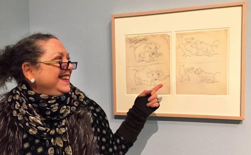 Rube Goldberg's granddaughter Jennifer George points to a cartoon that she and her grandfather worked on together when she was a child