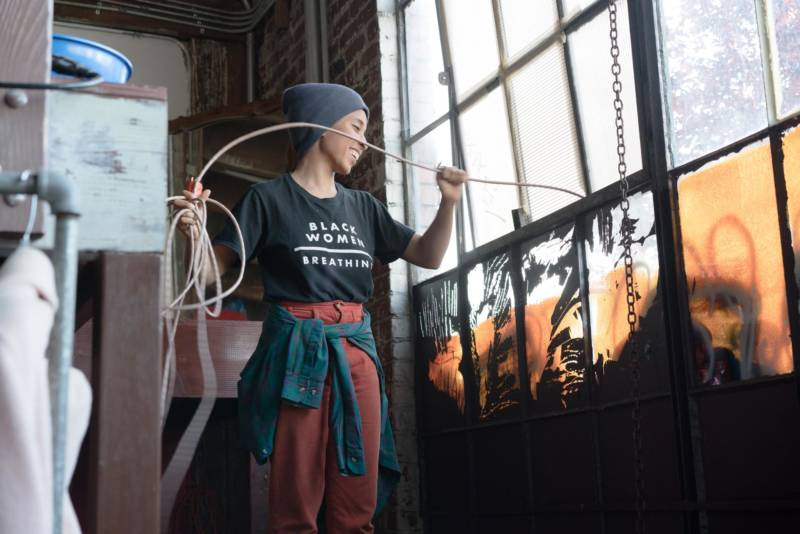 Sasha Kelley working at Alena Museum in West Oakland.