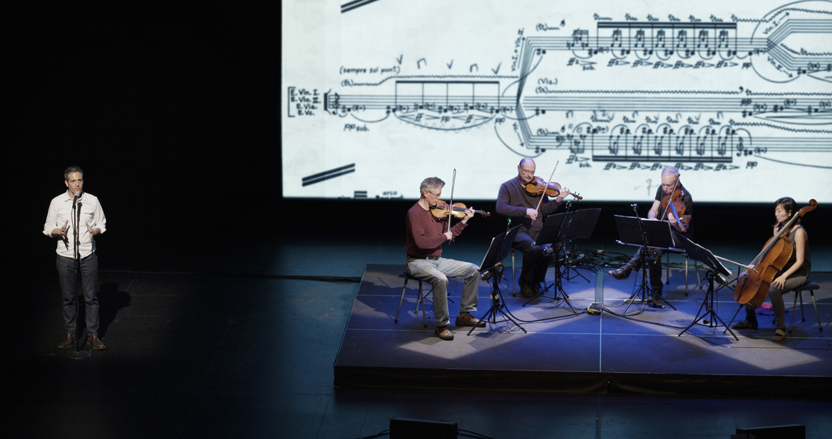 A scene from Sam Green and Joe Bini's 'A Thousand Thoughts: A Live Documentary by Sam Green and Kronos Quartet.'