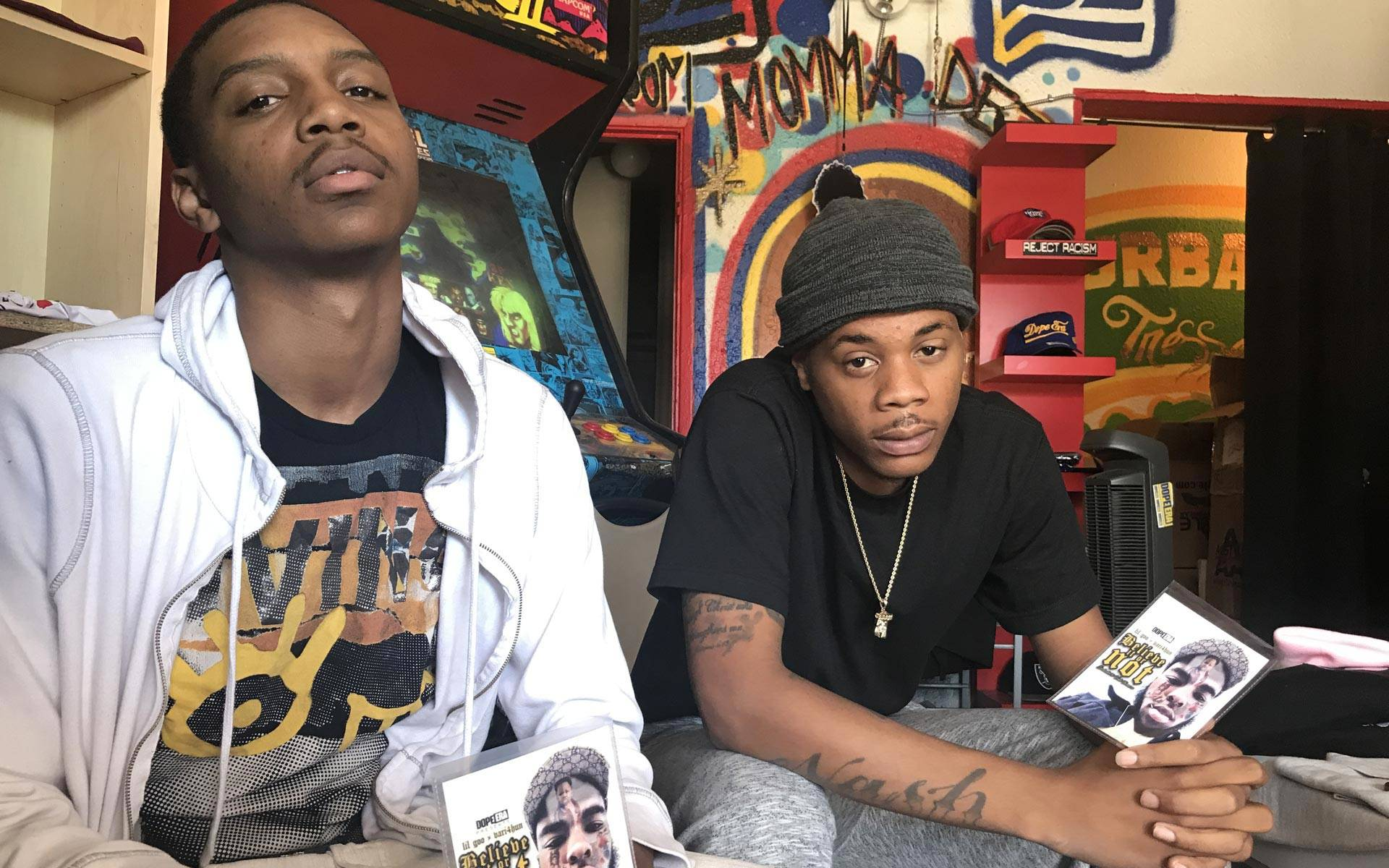Lil Goo and Vari4Hun at Dope Era in Oakland, holding copies of their album honoring Devonte Thomas. Pendarvis Harshaw
