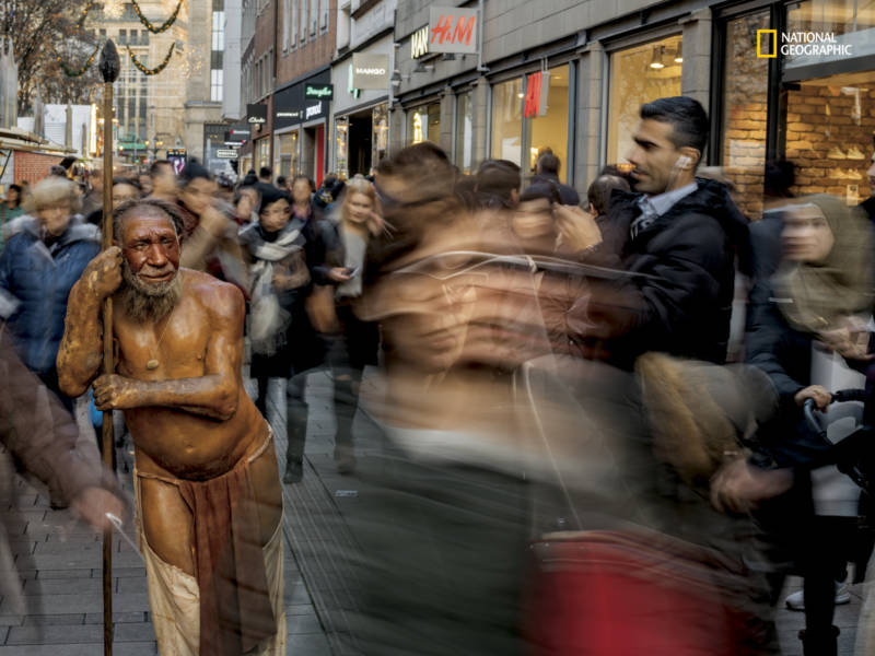 In Düsseldorf, Germany, a sculpture from the nearby Neanderthal Museum draws curiosity and recognition from passersby. The image is featured in the April issue of National Geographic magazine, a single-topic issue on the subject of race