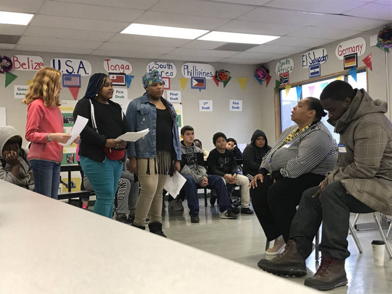 Mitzi Lewis, a formerly homeless Oakland resident, talks about her life experiences with students from Sol Middle School in East Oakland.