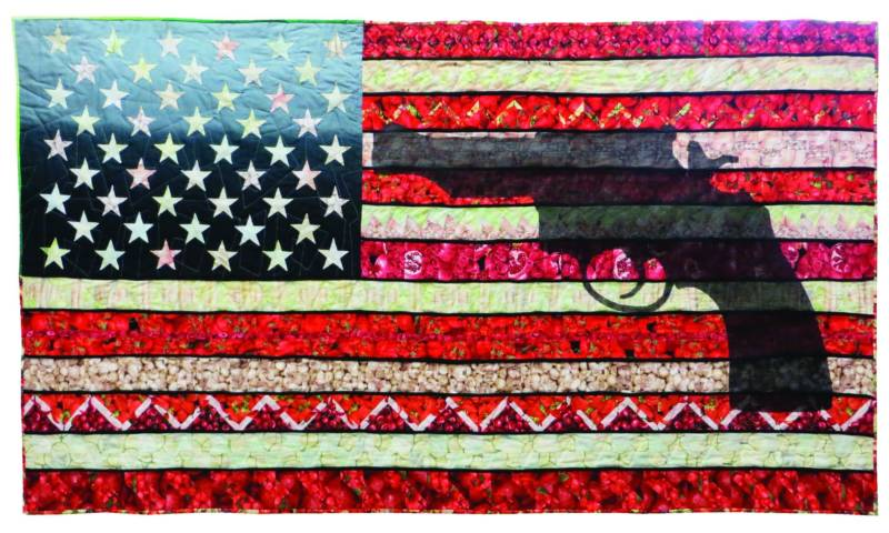 Michele Mackinen's quilt is part of the exhibition 'Guns: Loaded Conversations' at the San Jose Museum of Quilts and Textiles
