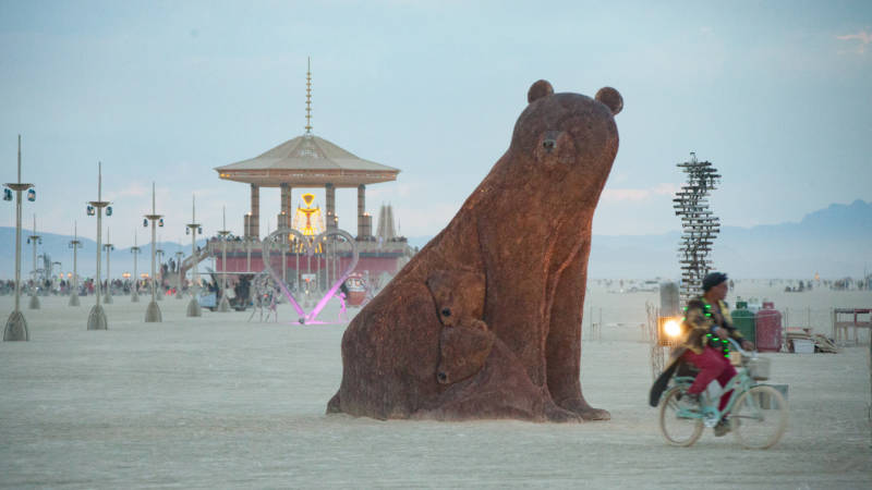 """Ursa Mater"" aka ""Mama Penny Bear"" on the Playa at Burning Man. ""It's battle tested,"" says Robert Ferguson. ""You're out in the desert in wind, blowing sand, heat, rain. And people are at it, 70,000 of them. At the end of the day, it comes home intact, you know you have something that's going to be able to be in the public eye."""