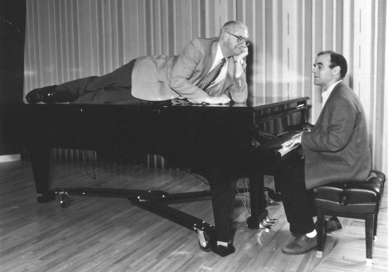 Kasell decides to take a publicity photo shoot up a notch while 'Wait Wait... Don't Tell Me!' host Peter Sagal tickles the ivories.