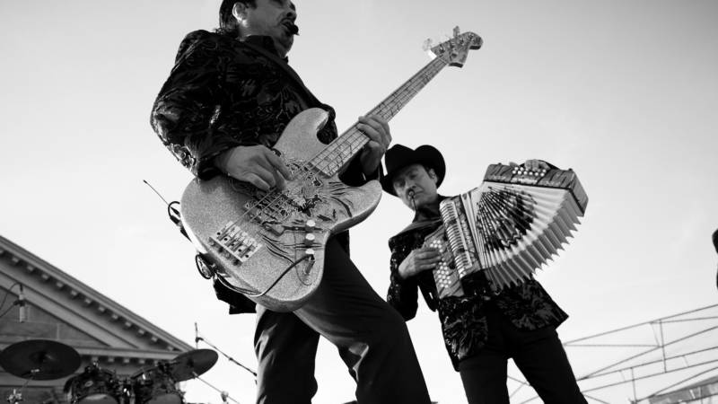 Hernán and Jorge Hernández from Los Tigres del Norte perform at Folsom State Prison.