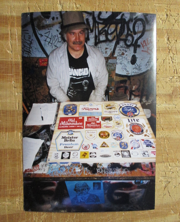 Steve Koepke selling patches and passing out The List at 924 Gilman.