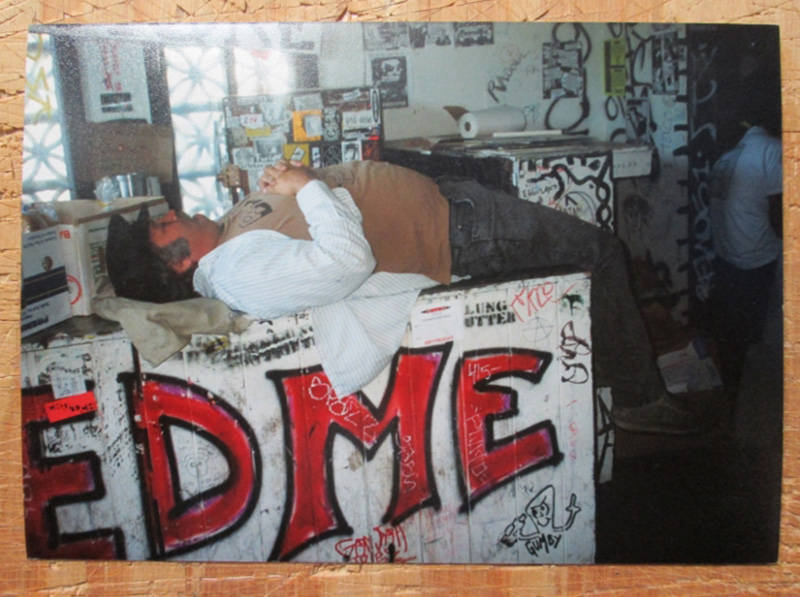 Steve Koepke lounging on a counter at the Gilman.
