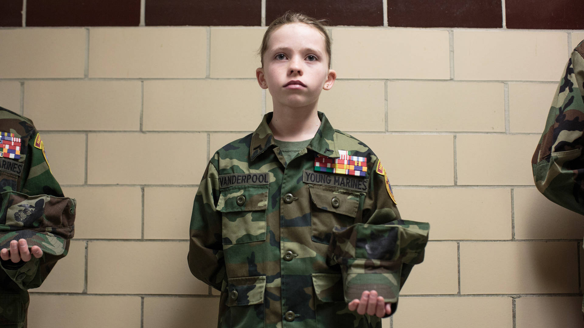 Sarah Blesener, from 'Beckon Us From Home,' 2017. An 11-year-old Young Marines recruit holds her pose during uniform inspection in Hanover, Pennsylvania. Courtesy of Sarah Blesener, 2017 CatchLight Fellow
