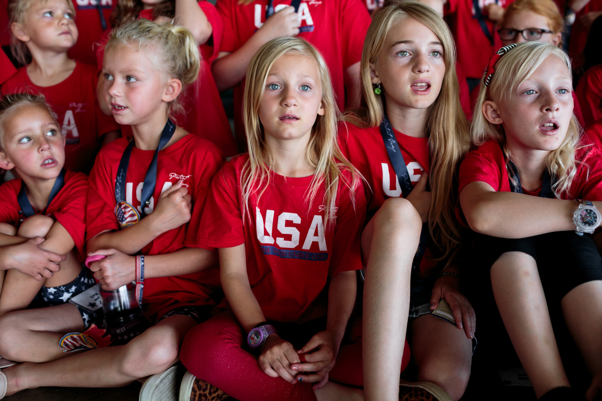 "Sarah Blesener, from 'Beckon Us From Home,' 2017. In Herriman, Utah, children at Utah Patriot Camp learn about ""Americanism,"" a blend of patriotism and history that casually mixes in some of the basic tenets of libertarianism."