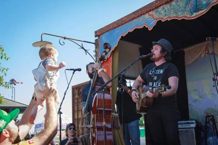 Even babies get into the action at the Railroad Square Musical Festival.